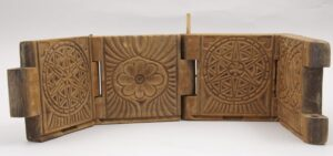 Four paneled butter mold with chip carving of floral and geometric designs - Decorative Woodcarving