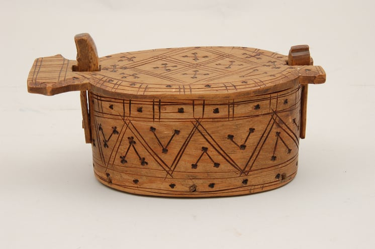 Body and top decorated with burnt and carved simple geometric crosses, triangles, and squares side - Decorative Woodcarving