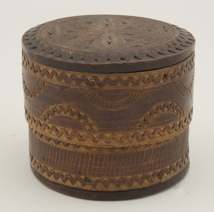Bentwood box top and bottom secured to sides with seven diagonal wooden pins front - Decorative Woodcarving