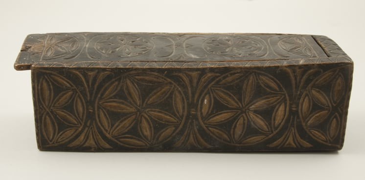 Box carved from one piece of wood with sliding top view of right side - Decorative Woodcarving