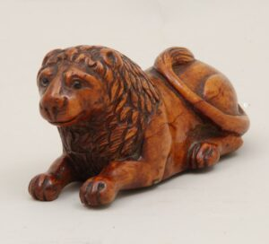 Hand carved from burl with realistic detailing on lion front - Decorative Woodcarving