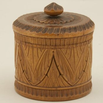 Turned cylindrical container with regular, shallow, relief covering on body and cover - Decorative Woodcarving