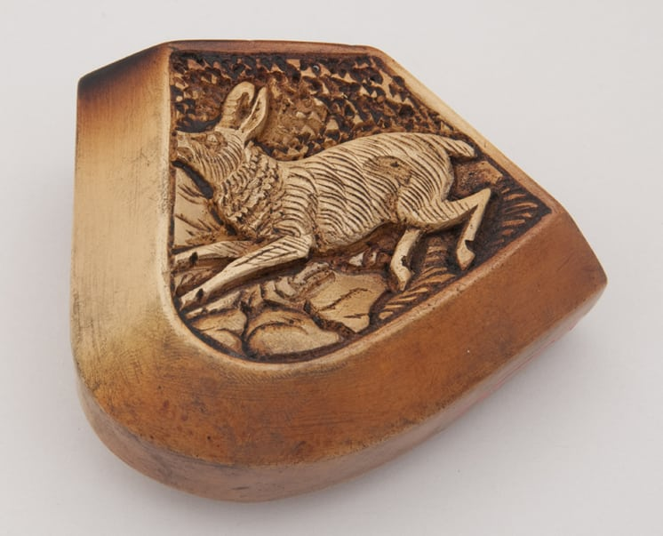Intricate carving of running hare on one side and castle on another left side - Decorative Woodcarving