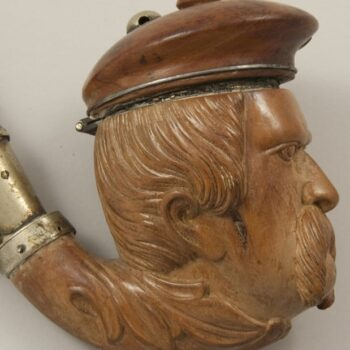 Long stemmed pipe with bowl in the shape of head of a man with a captain's hat closeup side - Decorative Woodcarving