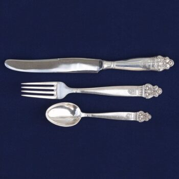 Flatware with an acanthus- like detail at the tip of each handle - Norwegian Metalworking