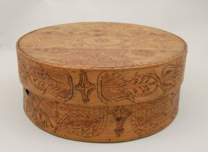 Bold stylized floral motifs burnt (pyrography) on cover and sides left side - Decorative Woodcarving