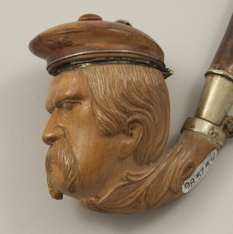 Long stemmed pipe with bowl in the shape of head of a man with a captain's hat closeup - Decorative Woodcarving