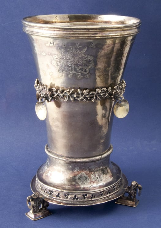 This beaker was engraved with coats of arms at the marriages of several generations of the noble Danish family of Juul