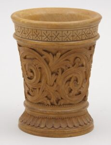 Body of beaker has acanthus relief carving with a punched background - Decorative Woodcarving