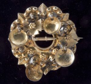 Brooch with bowl-shaped dangles alternating with Greek crosses - Norwegian Metalworking