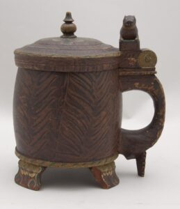 Large side handle riveted to body and topped with carved dog or bear side - Decorative Woodcarving