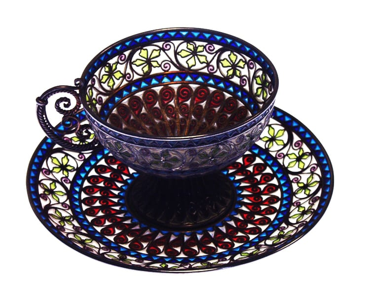 This tea cup and saucer were made using the plique à jour technique