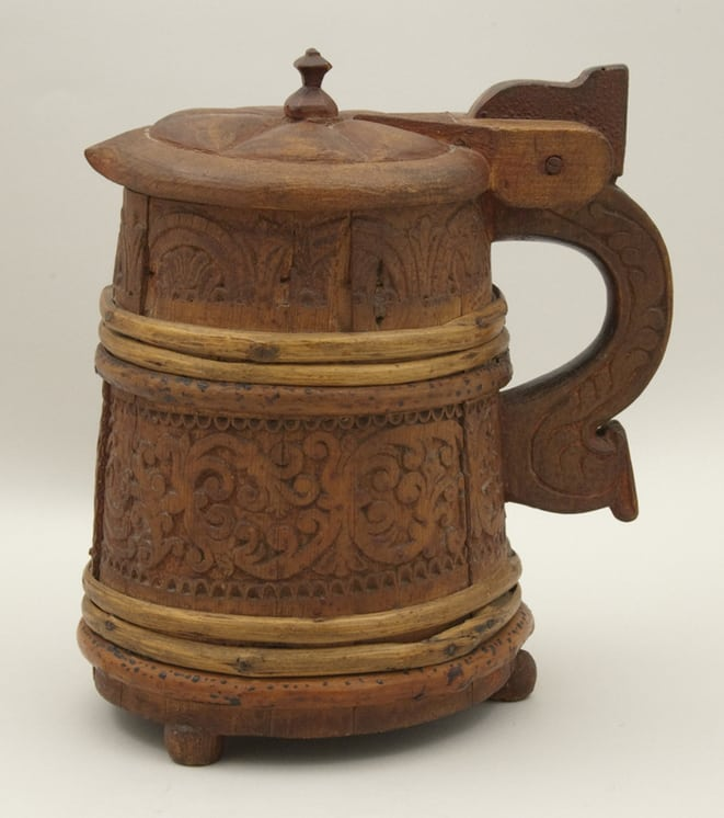 Tankard is of stave construction and held together by bentwood bands Side - Decorative Woodcarving