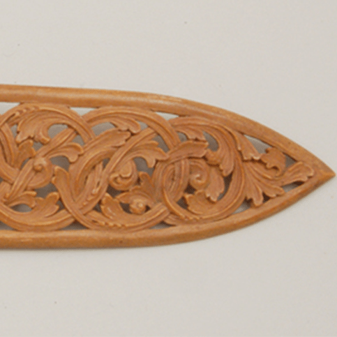 Hand carved wooden spoon with handle with open acanthus carving feature image - Decorative Woodcarving