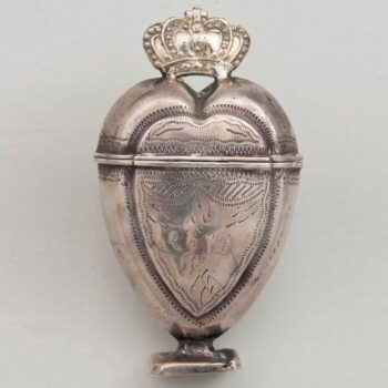 Perfume bottle in a long heart shape with a crown on top, square crop - Norwegian Metalworking