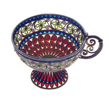 This tea cup and saucer were made using the plique à jour technique