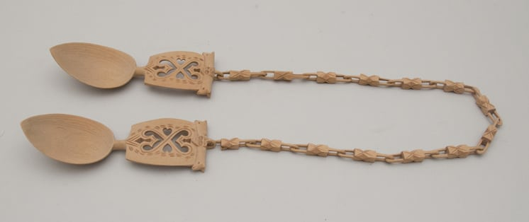 Well made hand-carved wedding spoons connected with geometrically decorated chain - Decorative Woodcarving