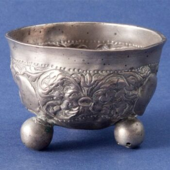 Wine cup with three hollow ball feet and repoussé and chased floral design - Norwegian Metalworking