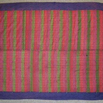 A unique hybrid textile of a handwoven coverlet that was later turned into a quilt
