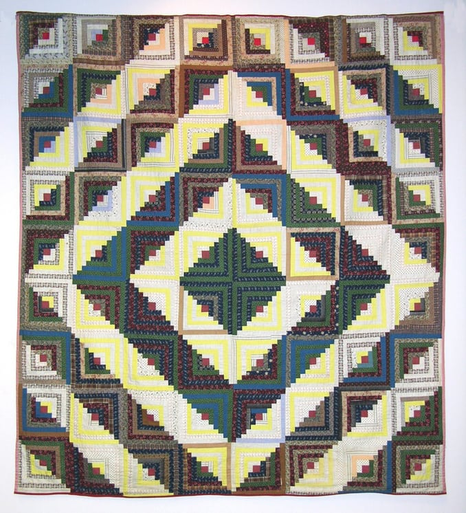 Log Cabin quilt made in the Barn Raising configuration - Textiles