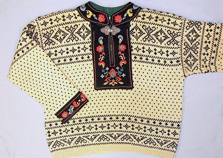 knit pullover sweater has the lice pattern and other traditional geometric Norwegian patterns in bands across the shoulders and waist - Textiles