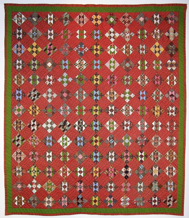 Colorful pieced quilt made in an equal nine patch variation - Textiles