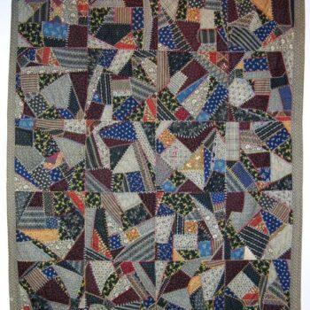 Crazy quilt is made of primarily dark cotton prints - Textiles
