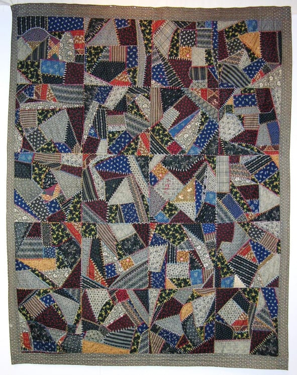 Crazy quilt is made of primarily dark cotton prints - Textiles