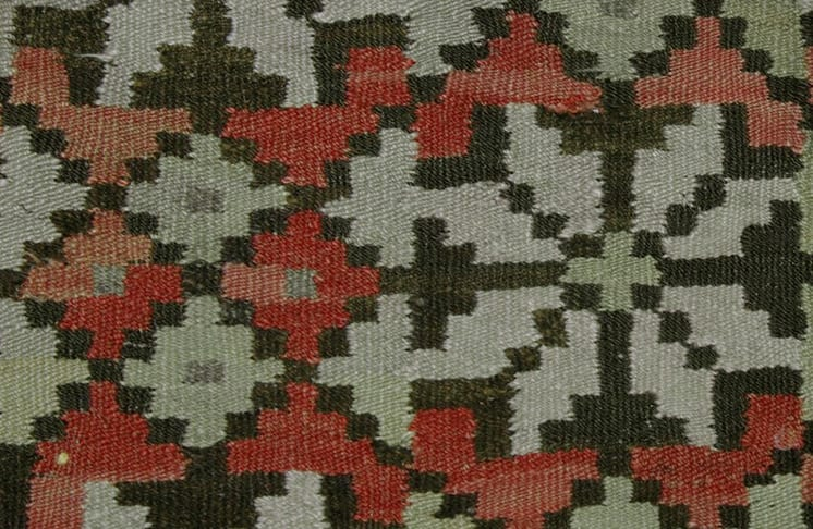 Coverlet with zigzags, crosses, and lightning borders are at the top and bottom - Textiles