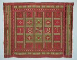 Coverlet with long-eyed heddles with inlayed inscriptions and other geometric designs - Textiles
