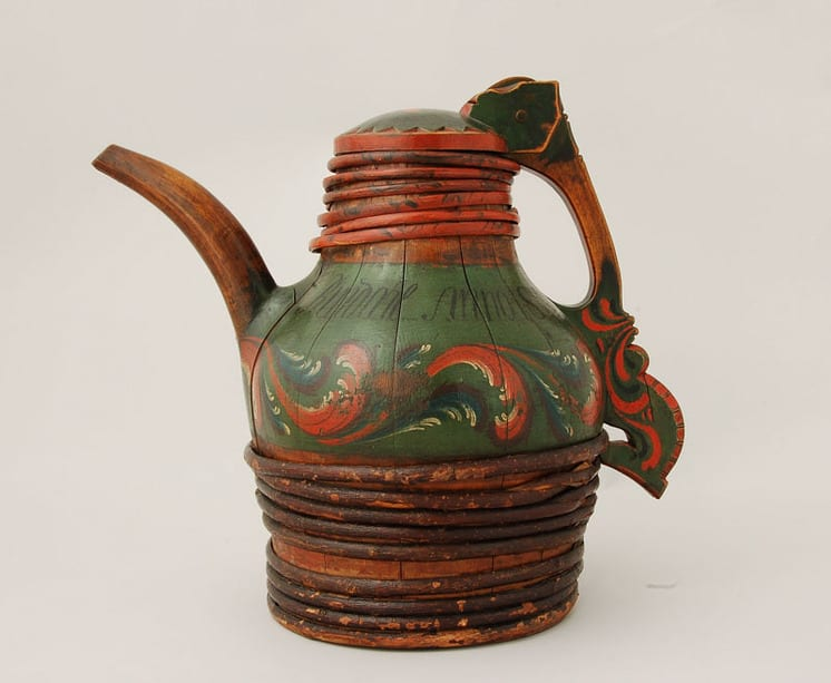 Large handle has a horse-head motif at base and wood pin at top that holds domed wood cover - Rosemaling