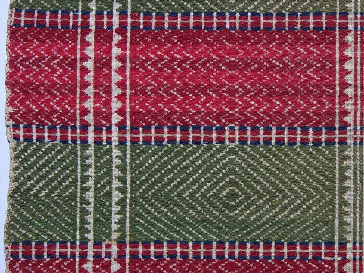 Skillbragd coverlet woven in a twill diamond overshot pattern using homespun and dyed wool - Textiles