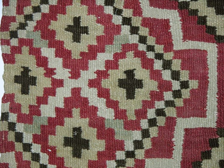 Coverlet with eight-pointed stars and diamond motifs divided by diagonal zigzag borders - Textiles