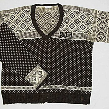 Brown and white knit sweater with a lice pattern across the torso - Textiles