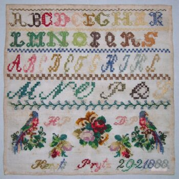 Sampler (navneduk) with floral designs, two birds, initials, and letters of the alphabet
