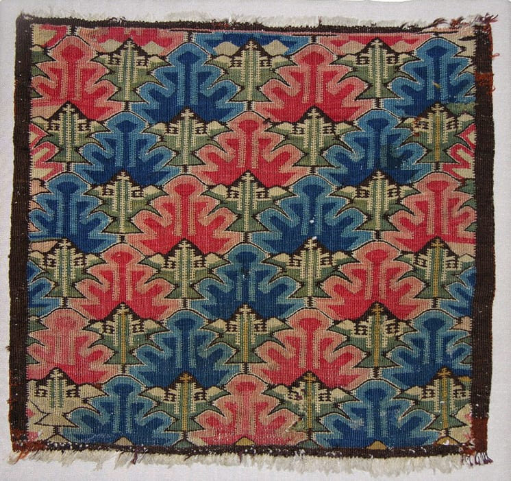 A cushion cover done in the traditional skybragd (cloud) pattern - Textiles