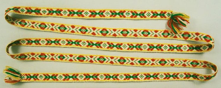 The belt has a green needlepoint background with beaded design - Textiles