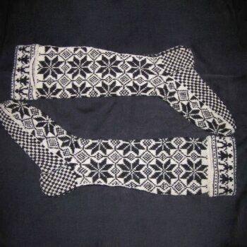 Hand-knit socks made of heavy wool with eight-petal flowers pattern in black - Textiles