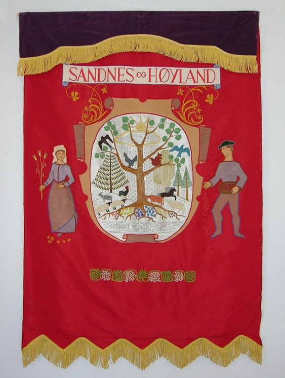 Banner features a scroll and oval with a stylized forest scene that has been appliquéd and embroidered - Textiles