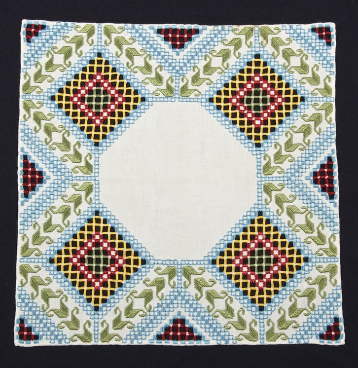 Doily with Hardanger embroidery in green, red, yellow, and blue - Textiles