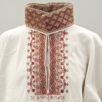 Blouse with three-inch tall standing collar that is covered with fine and dense cross-stitch - Textiles