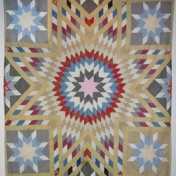 Pieced quilt top is done in the blazing star - Textiles