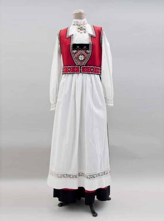 Dress with a black skirt and a geometric beaded breastplate - Textiles
