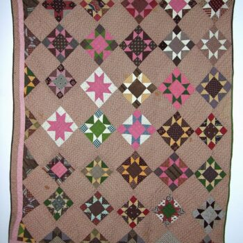 Quilt constructed with blocks of eight-pointed stars