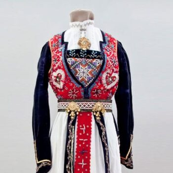Dress with decorated with gold metallic lace and extensive bead work in blue, black, clear, and gold beads - Textiles