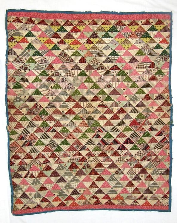 Nineteenth century calico baby quilt is made of 1.5 x 2 inch triangles - Textiles
