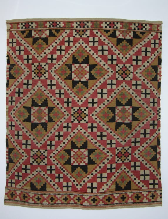 Coverlet woven in a pattern of crosses, diamonds, and eight-petal flowers in rutevev - Textiles