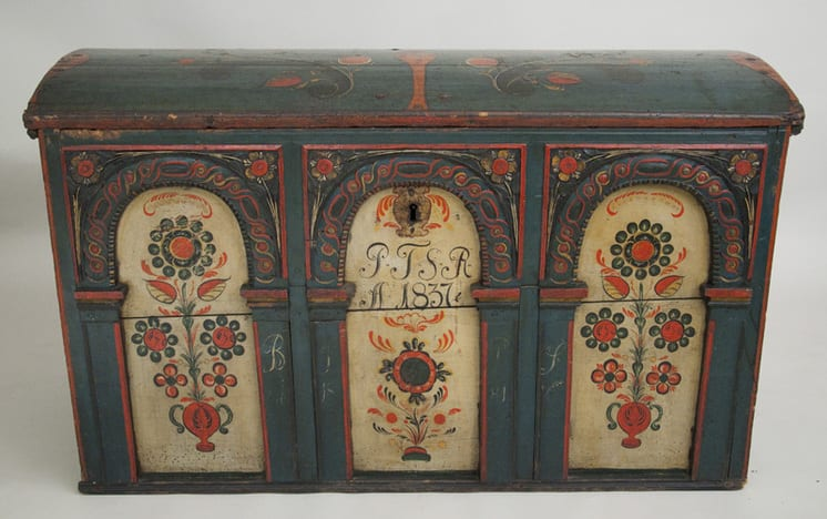 The trunk originally held money and medicine and was found in an abandoned Native American fishing hut - Rosemaling