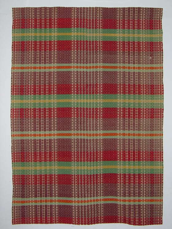 Coverlet with pattern wool in vertical bands of diamond forms on red, orange, yellow, pastel green and mauve horizontal bands - Textiles