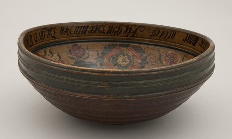 Carved and turned ale bowl made from one piece of wood side